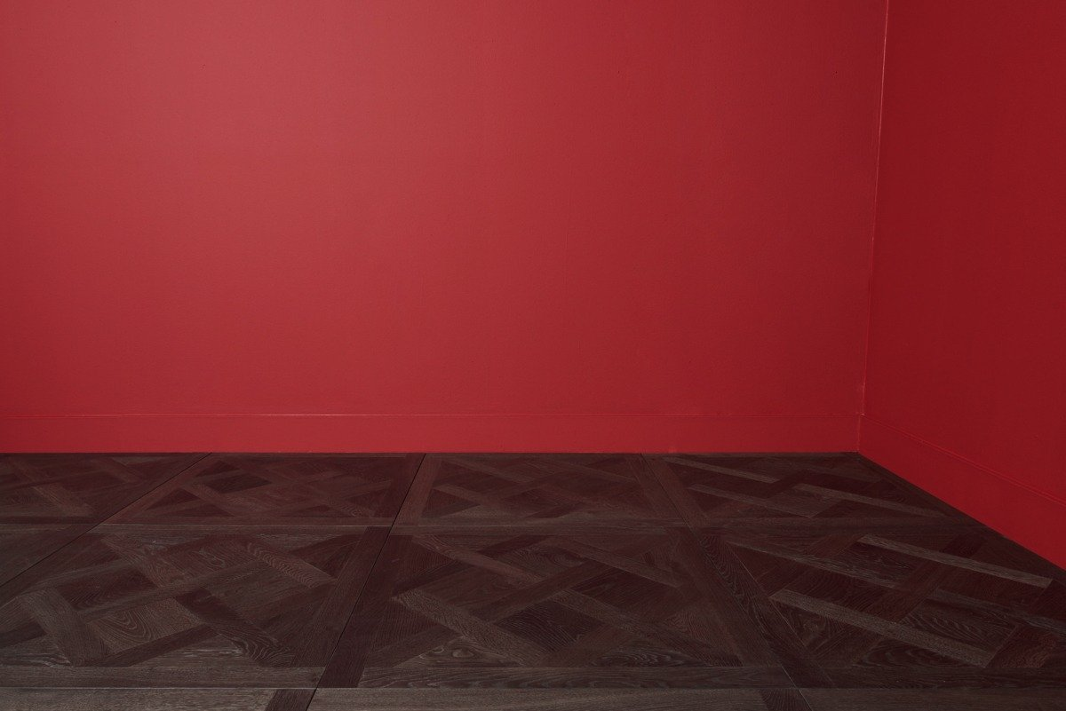 Traino flooring and right corner red walls