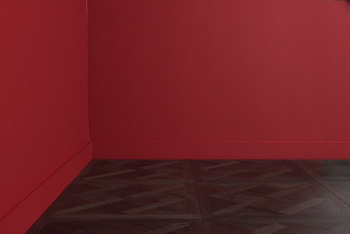 Traino flooring and left corner red walls