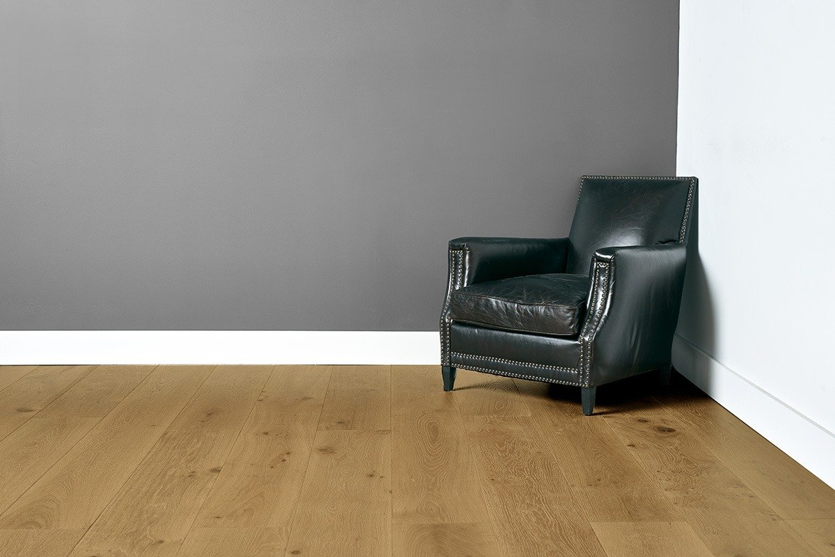 Sunrise flooring with grey and white walls and black chair in the right corner