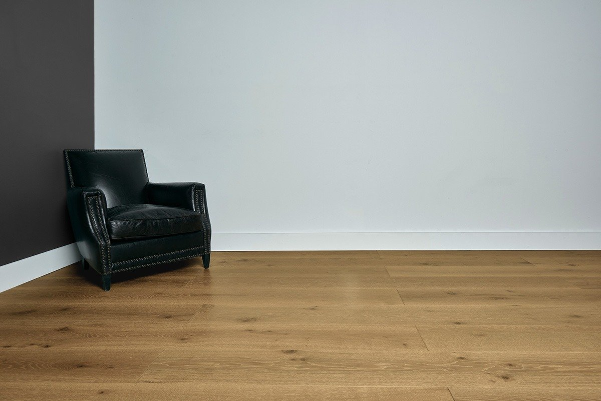Sunrise flooring with grey and white walls and black chair in the left corner
