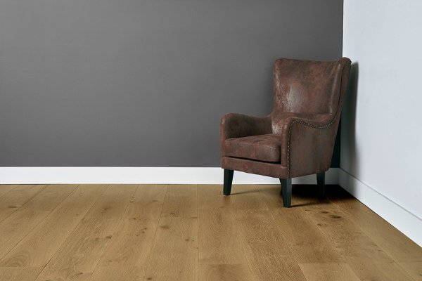 Sunrise flooring with grey and white walls and leather chair in the right corner