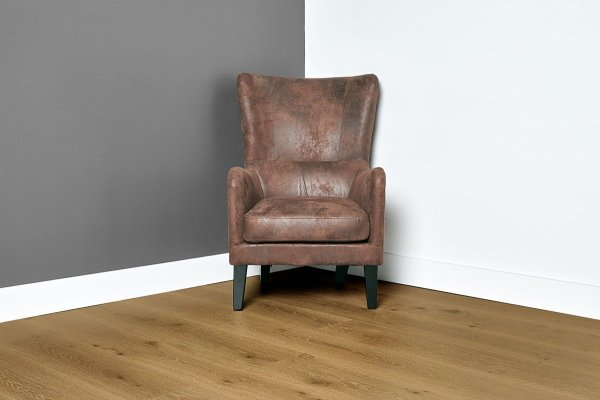 Sunrise flooring with grey and white walls and leather chair in the center