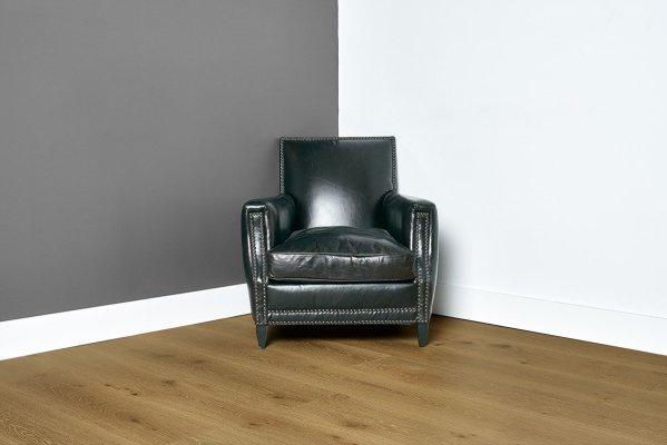 Sunrise flooring with grey and white walls and black chair in the center