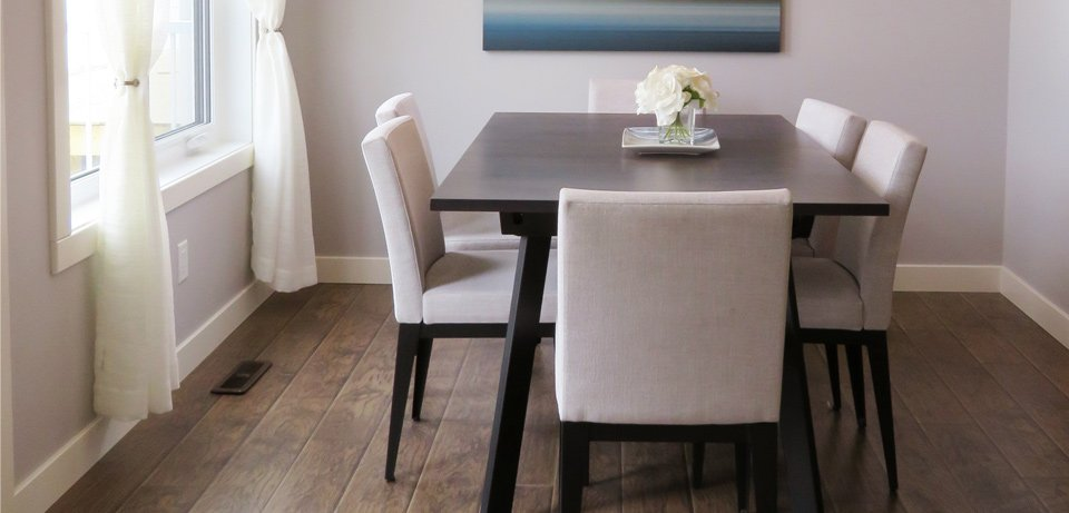 Dark Flooring Dinning Room with Chairs