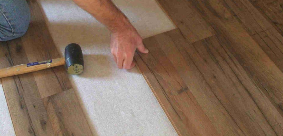 Dark Flooring Installer with Rubber Mallet