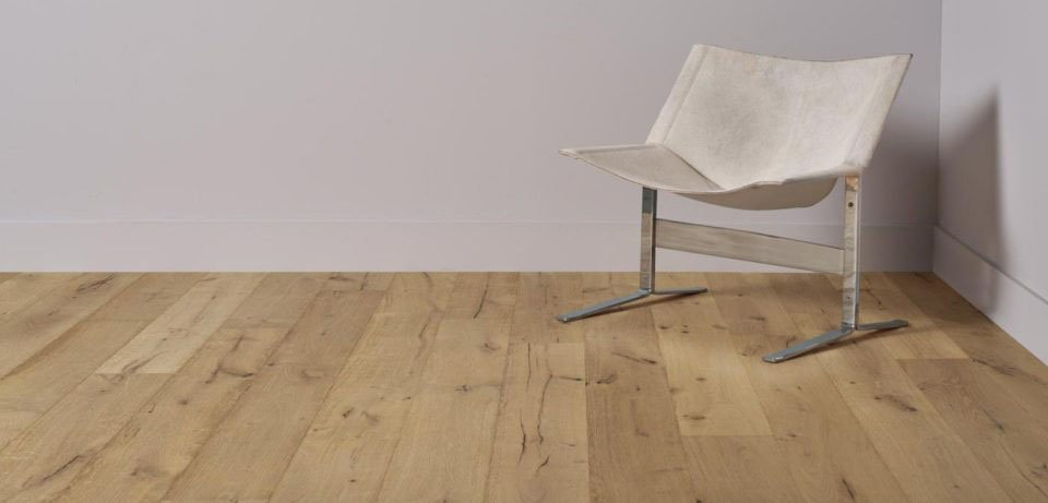Natural Flooring Single Chair in Corner on Grey Wall