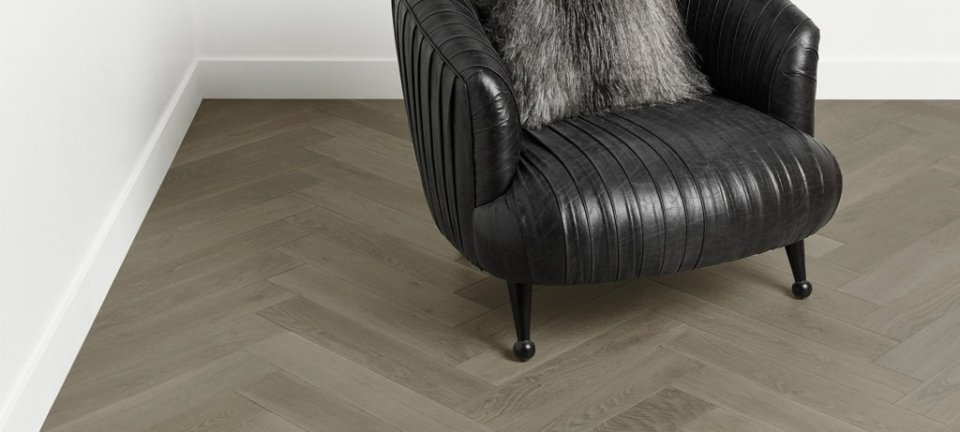 Herringbone Flooring Leather Chair White Walls
